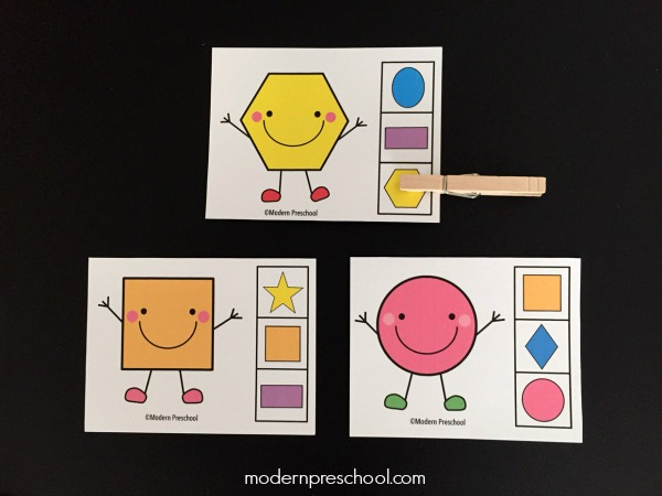 FREE printable shape match clip cards for toddlers and preschoolers. Match the shapes in this independent busy bag activity! Works great as a math center that focuses on visual discrimination, matching, and fine motor skills.