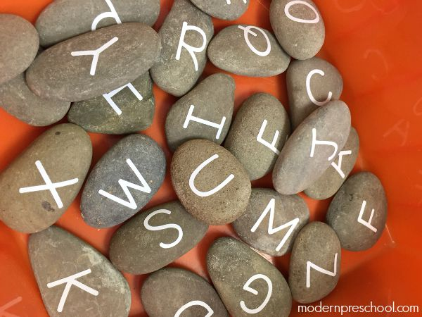 Alphabet letter learning stones for preschoolers during circle time | Modern Preschool