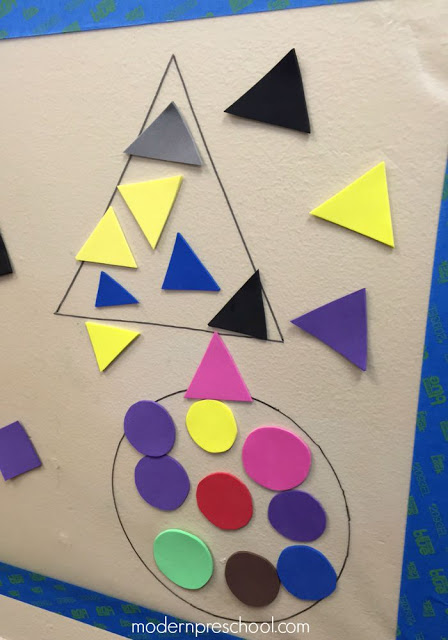 Shape sorting sticky wall with reusable craft foam stickers from Modern Preschool!