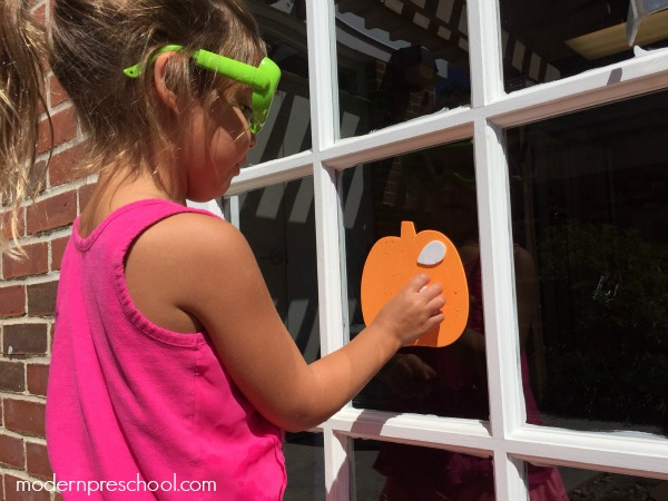 Counting pumpkin seeds with reusable window stickers - perfect activity for toddlers and preschoolers!