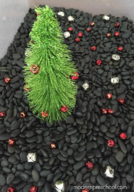 Jingle Bell Rock Christmas fine motor sensory bin for toddlers & preschoolers from Modern Preschool!