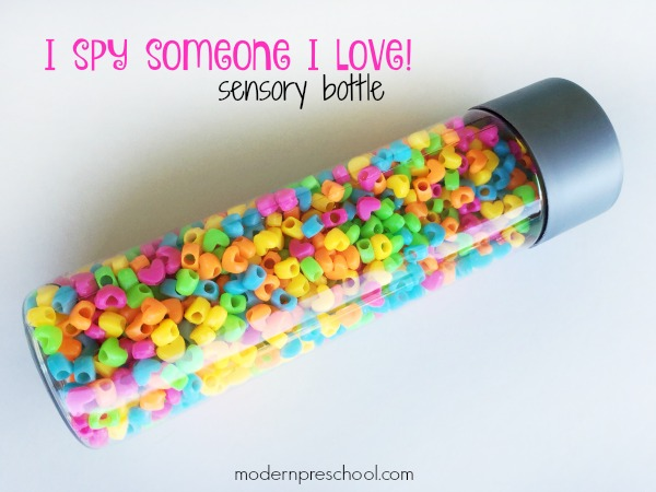 "Super simple ""I Spy Love"" Sensory Bottle for toddlers and preschoolers to practice visual discrimination, identification skills, and calming down during circle time, in a reading corner, or at home during a Valentine's Day or hearts theme!"
