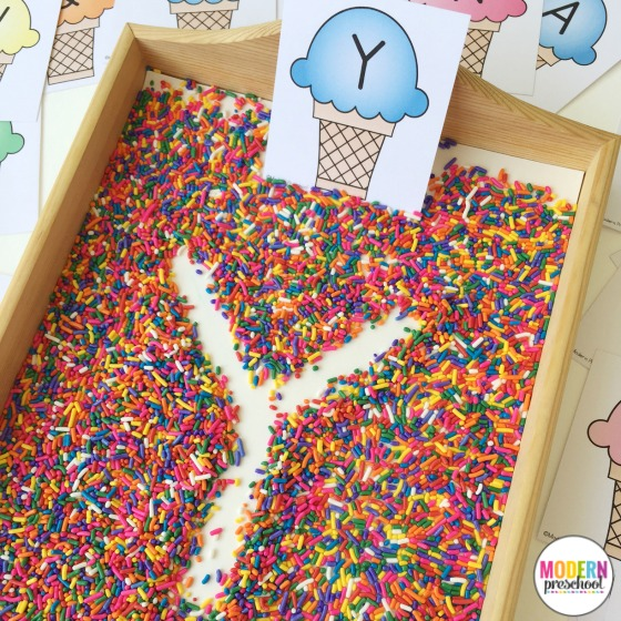 Free printable ice cream and sprinkles alphabet writing practice cards for this super simple sprinkle filled writing tray! Practice pre-writing and fine motor skills. The perfect activity to motivate and engage preschoolers and kindergarteners!