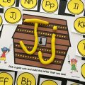 FREE pirate alphabet play dough mats for kids to practice uppercase and lowercase letter formation and recognition with gold coins and a treasure chest!