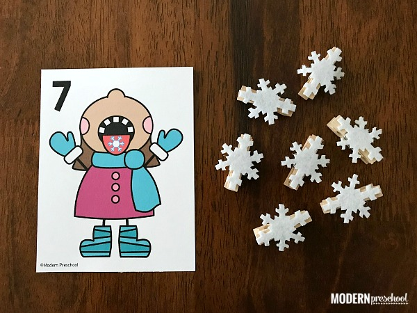 FREE printable Catching Snowflakes Counting Cards 1-12 to use during January and your winter theme to practice counting, numbers, and 1:1 correspondence with this super simple math center for preschool, pre-k, kindergarten at home or in school!