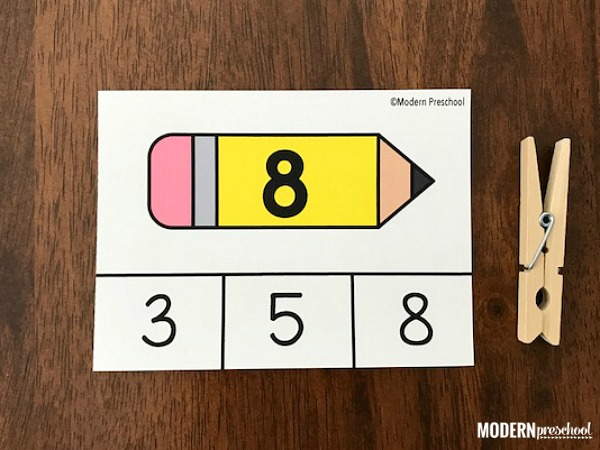 FREE printable school pencil number match clip cards 1-20 to focus on numbers, visual discrimination, and fine motor skills as you go back to preschool!